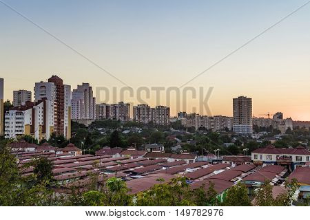 BELGOROD RUSSIA - SEPTEMBER 10 2016: Neighborhood of low-rise residential buildings with multi-storey buildings on a slope. Old street market