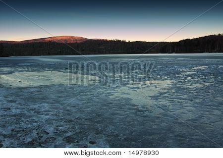 dusk over frozen lake