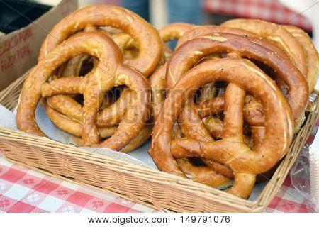 Basket of soft salty pretzels at a stand at a German street fair