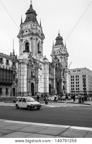 LIMA PERU - SEPTEMBER 21 2016: City Life in Front of The Basilica Cathedral at the Plaza Mayor in Lima Peru.