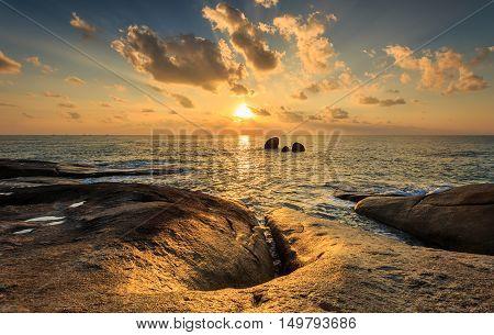 Landscape of Hin Ta Hin Yai and sunrise at Samui Thailand