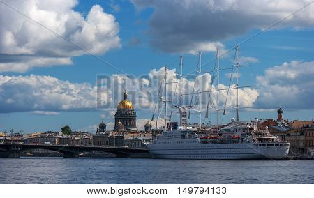 St. Petersbug Russia - August 5 2015: Cruise liner Wind Surf of Windstar Cruises Luxury Lines departs from the Neva river. The 5-masts ship provides luxury cruise for 310 guests