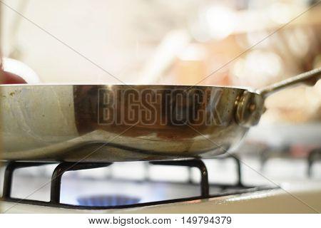 Wooden spatula stirring food in saute pan