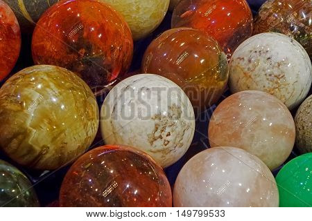 Energy stones polished in round shape and placed behind a glass.