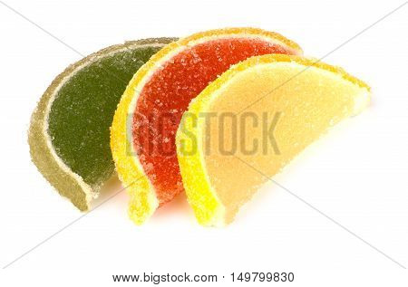 Marmalade In Form Of Slices Of Citrus Fruits On White