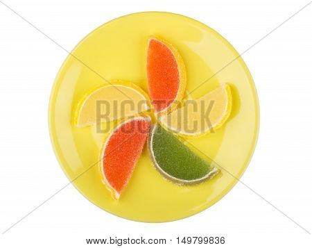 Marmalade In Form Of Citrus Fruits On Saucer On White