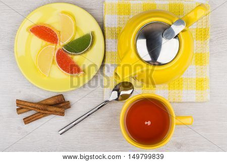 Marmalade, Hot Tea And Teapot, Cinnamon Sticks On Wooden Table