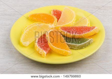 Multicolor Marmalade In Form Of Citrus In Saucer On Table