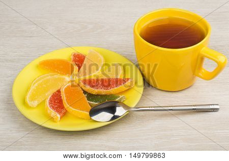 Multicolor Marmalade In Saucer And Tea On Table