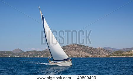 Sailing in the wind through waves. Luxury yacht boat in race.