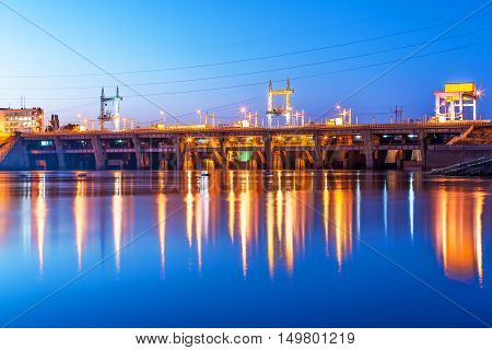 Scenic summer night industrial view of Kyiv Hydroelectric Power Plant dam on Dnieper river in Vyshgorod, Ukraine