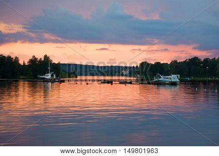 SAVONLINNA, FINLAND - AUGUST 20, 2016: August sunset on lake Saimaa. Tourist landmark of the city Savonlinna, Finland.