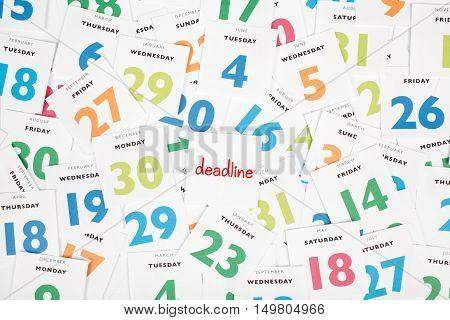 Deadline business concept. Calendar scraps, one with text deadline.