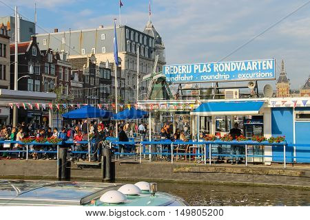 Amsterdam the Netherlands - October 03 2015: People near the canal in historic city centre