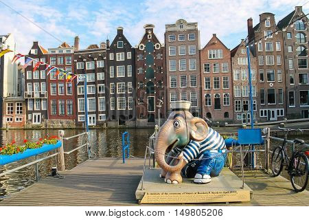 Amsterdam the Netherlands - October 03 2015: Sculpture of elephant sailor at berth near the water in city centre