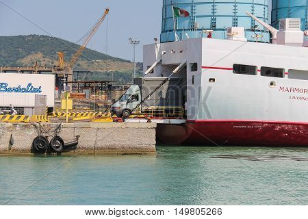Piombino Italy - June 30 2015: Ferry boat Marmorica unload a vehicle. Ferry with capacity 470 passengers and 106 vehicles