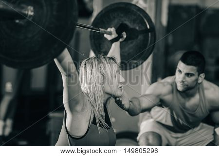 Weightlifting training, black and white, selective focus
