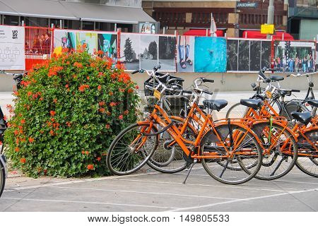 Amsterdam the Netherlands - October 03 2015: Parked bicycles on the picturesque city street