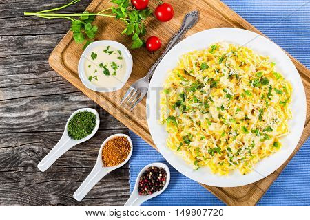 Fettuccine Alfredo served in a sauce of cream butter and grated Parmesan cheese sprinkled with parsley. view from above