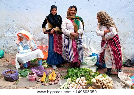 CHEFCHAOUEN, MOROCCO - JANUARY 2, 2014: Smiling muslim women poses for a photo in the souk.