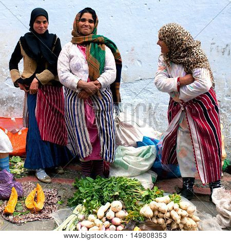 Women Poses For A Photo In The Souk In Chefchaouen, Morocco