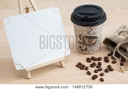 coffee beans and a cup on a wooden surface disposable tableware title