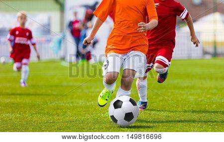 Youth Soccer League. Young soccer football players kicking soccer ball on sports field. International soccer league tournament for youth football teams