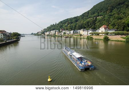 HEIDELBERG, GERMANY - SEPTEMBER 15: Tourists going by the sightseeing boat Neckarsonne at the river Neckar in the city Heidelberg in Germany,  on September 15, 2016.