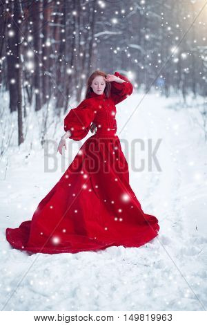 Young Beautiful Woman In Long Red Dress Over Winter Background.