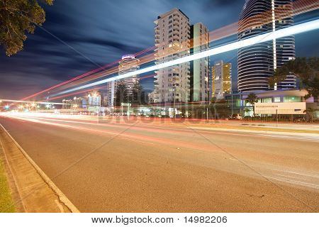 Light Trails Over Modern City At Night