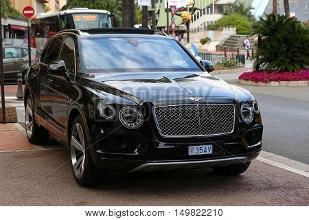 Monte-Carlo Monaco - May 18 2016: Black Bentley Bentayga Luxury SUV (Front View) At The City Street in Monaco French Riviera