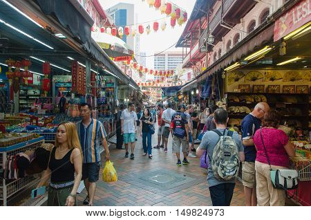 singapore singapore - September 20 2014: Crowds walk through a Chinatown market in singapore