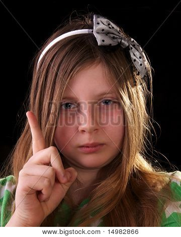 Young Girl Scolding And Waving Her Finger