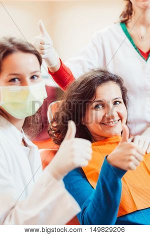 Happy female patient after tooth extraction posing