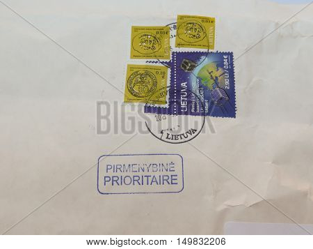 VILNIUS LITHUANIA - CIRCA FEBRUARY 2015: mail stamps with postage meter over priority (pirmenybine prioritaire) mail envelope