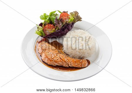 Front view of Fusion food style grilled salmon dressed with Japanese sweet sauce (Teriyaki) including Thai rice garnished with vegetables in ceramic dish isolated on white background