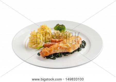 Front view of Modern cuisine style fried salmon with spinach mashed potatoes and grilled vegetables in ceramic dish. Clean eating cuisine concept isolated on white background