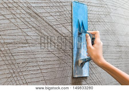 Worker Plastering Concrete At Wall