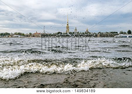 Saint-Petersburg.Russia.September 3 2016.Splashing waves on the river Neva and view of Peter and Paul fortress in Saint-Petersburg.