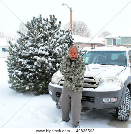 African american male expressions in the winter snow outdoors.