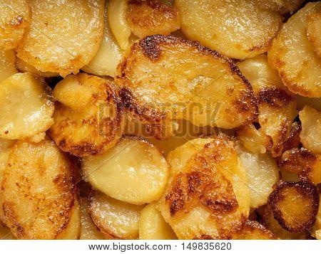 close up of rustic golden german pan fried potato bratkartofflen food background