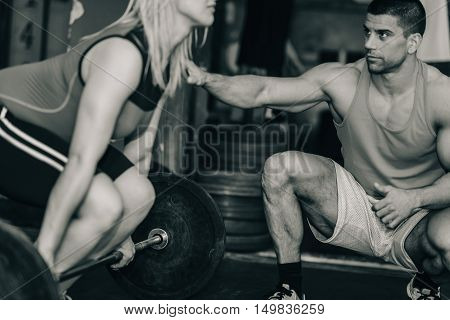 Weightlifting training, black and white image, horizontal