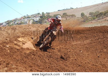Motocross Rider Roosting The Corner