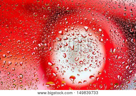 Abstract texture - Water drops on glass with car background