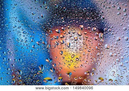 Abstract texture - Water drops on glass with lamp background