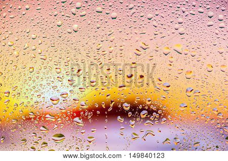 Abstract texture - Water drops on glass with nice sunset background