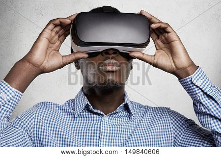 People, Technology, Cyberspace And Entertainment Concept. African Man Dressed In Checkered Shirt Usi