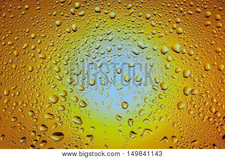 Abstract texture - Water drops on glass with sun background
