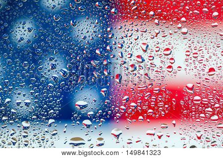Abstract texture - Water drops on glass with USA flag background