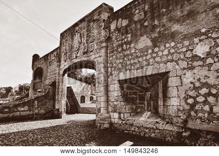 Door of Alcazar de Colon. Santo Domingo, Dominican Republic. Orange Sepia version of the shot.